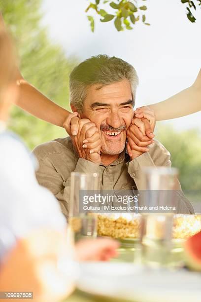 Older man having birthday celebration