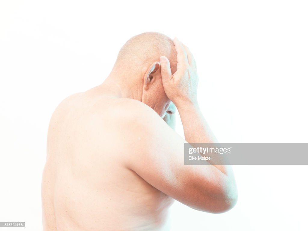 older man holding his head : Stock Photo