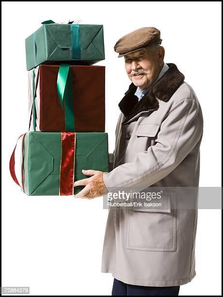 Older man holding presents