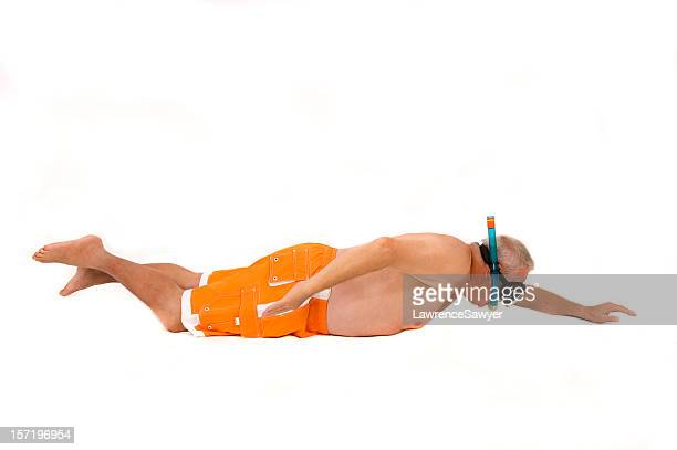 older man in swimmers and snorkel against a white background - zwembroek stockfoto's en -beelden