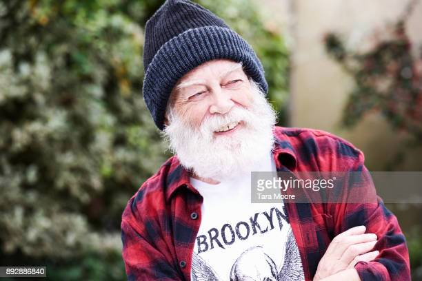 older man laughing - red hat stock pictures, royalty-free photos & images
