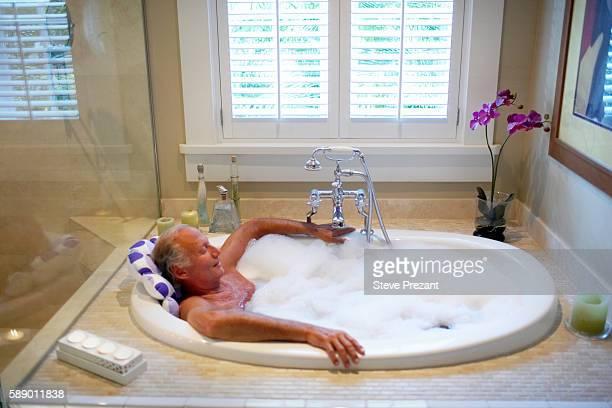 Older Man Relaxing in Bubble Bath