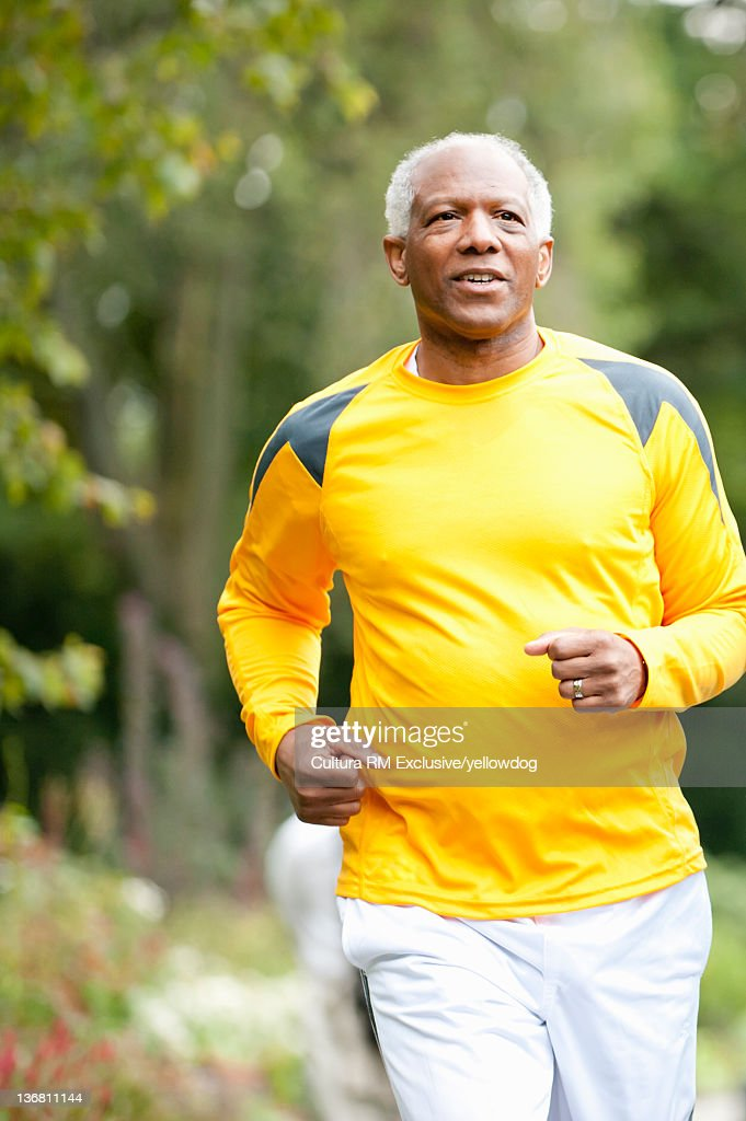 Older man running in park : Stock Photo