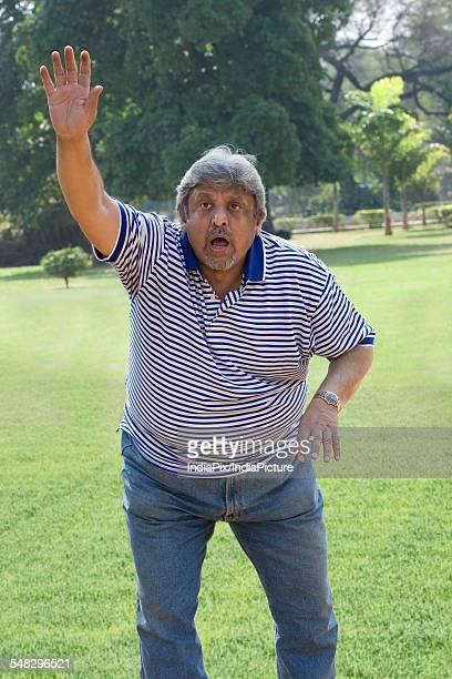 Older man signalling to stop