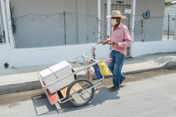 older man street vendor at covid-19