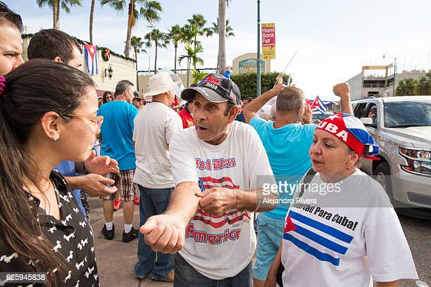 older man talking - cuban flag stock pictures, royalty-free photos & images