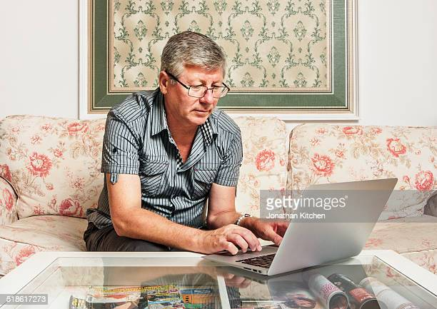Older man using a laptop
