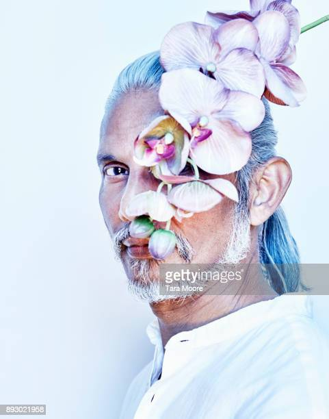 older man with flowers