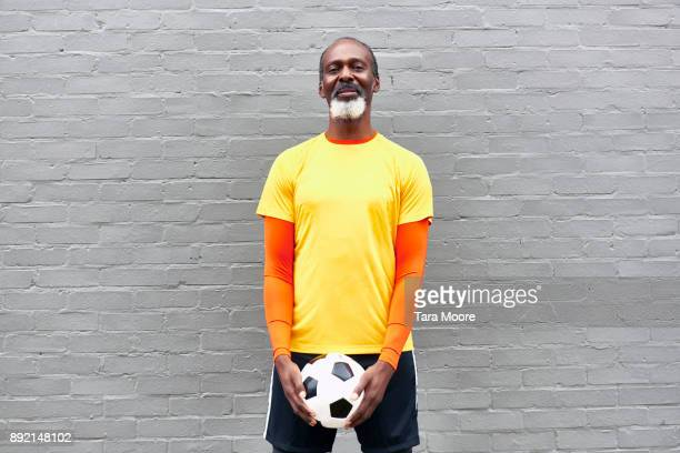 Older man with football