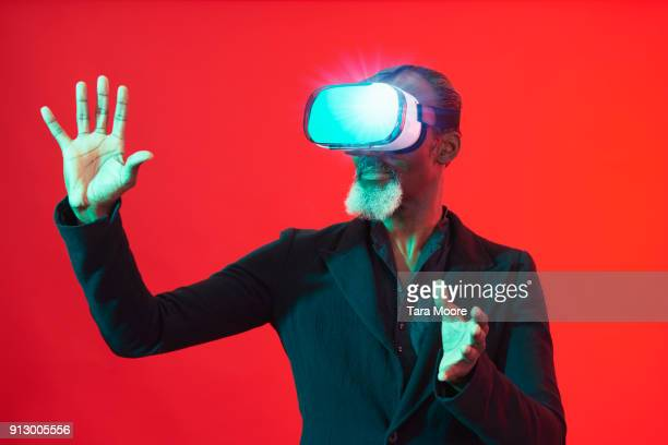 older man with vr headset - virtual reality simulator stock photos and pictures
