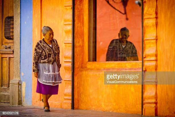 older mayan woman in streets of antigua, guatemala. - guatemala stock pictures, royalty-free photos & images