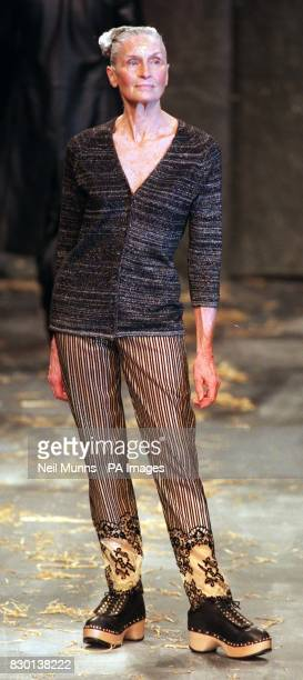 Older model Daphne Selfe wears a cardigan striped trousers and laceup clogs from the Andrew Groves show during London Fashion Week