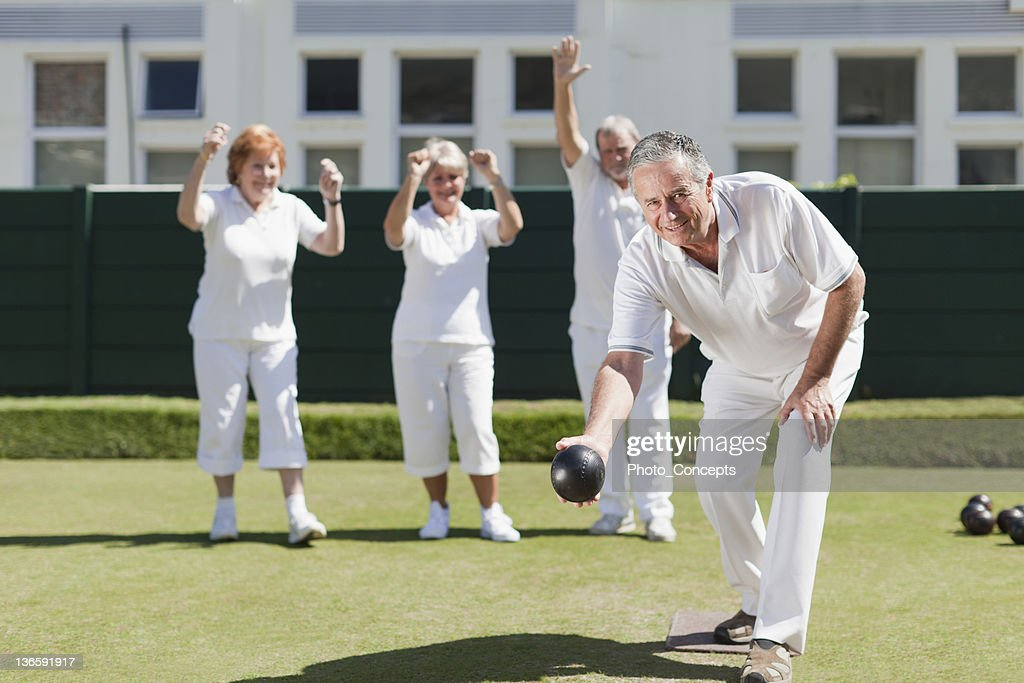 Older people playing lawn bowling : Stock Photo