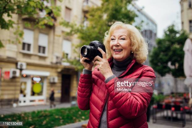 older photographer in the city area - photography themes stock pictures, royalty-free photos & images