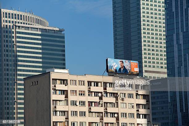 Older residential properties center sit surrounded by new commercial buildings in Warsaw Poland on Monday Jan 9 2017 Investors in Poland are betting...