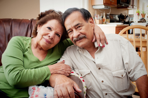 Older, retired couple on couch - gettyimageskorea