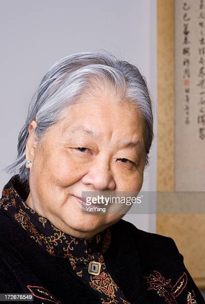 Older Senior Asian Chinese Woman Gracefully Smiling in Dignified Retirement