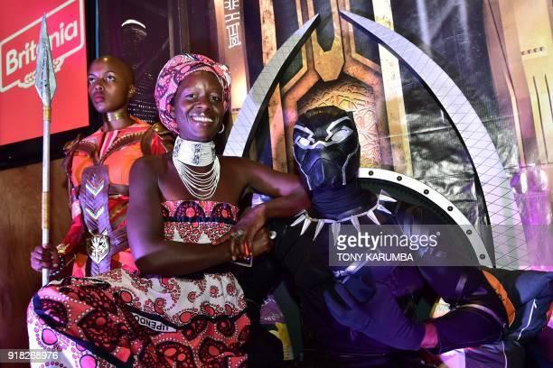 Older sister of Oscar winning Kenyan actress Lupita Nyong'o Zawadi Nyong'o poses with a cosplayer portraying the leading character in the 2018 US...