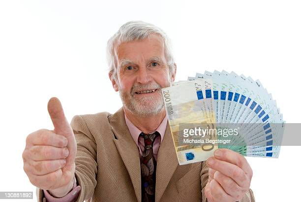 Older, successful man with money