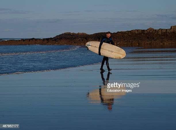Older surfer Bude Cornwall UK