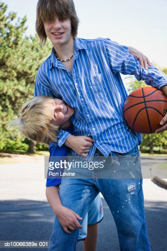 Older Teen Brother Head Under Arm Playing In Suburban Street Stock Photo  Getty Images-6911