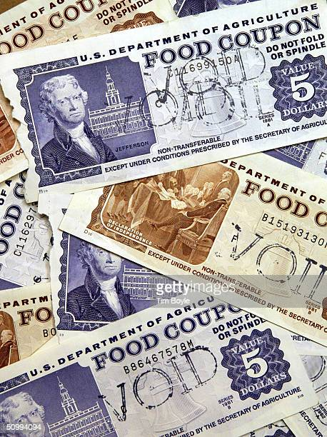 Older traditional food stamps are displayed June 24 2004 at an Illinois Department of Human Services office in Skokie Illinois Agriculture Secretary...