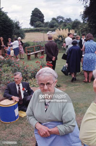 Older village residents socialise during the church fete in the Rectory garden at Pembridge in England circa June 1966 During the summer of 1966...