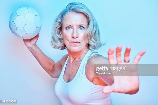 older woman aiming ball