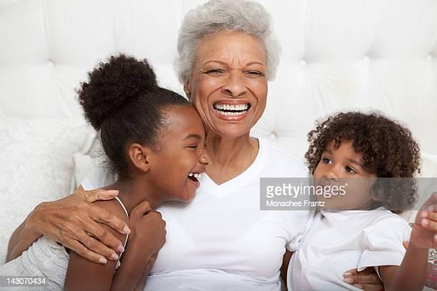 Older woman and grandchildren hugging
