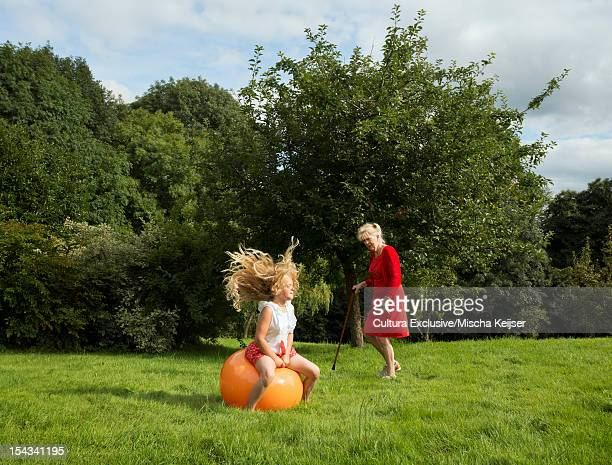 Older woman and granddaughter in meadow