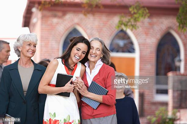 older woman and granddaughter laughing - congregation stock pictures, royalty-free photos & images