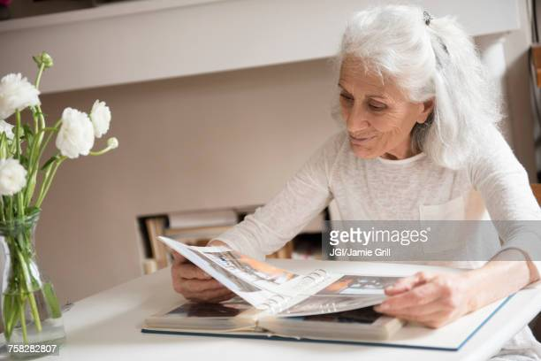 Older woman enjoying photo album