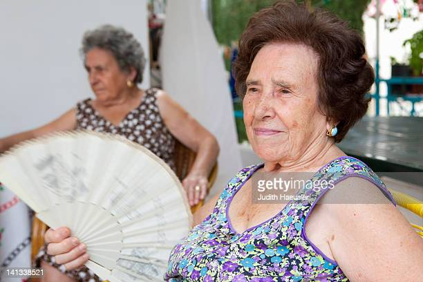 older woman fanning herself outdoors - heat stock pictures, royalty-free photos & images