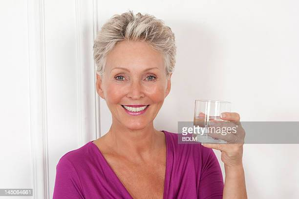 Older woman having glass of water