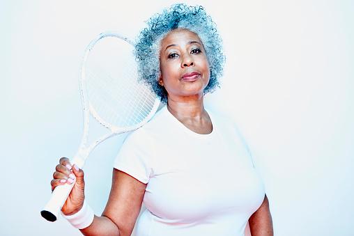 older woman holding tennis racket - gettyimageskorea
