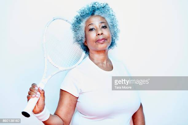 older woman holding tennis racket
