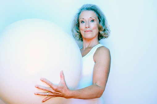 older woman holding yoga ball - gettyimageskorea