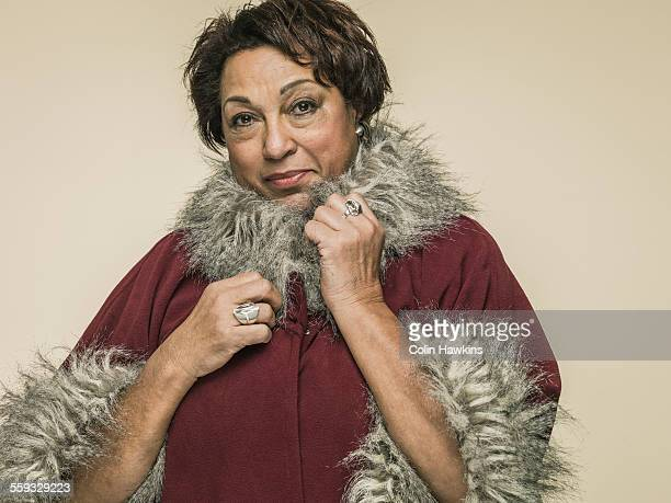 older woman in fur trimmed coat - colin hawkins stock pictures, royalty-free photos & images