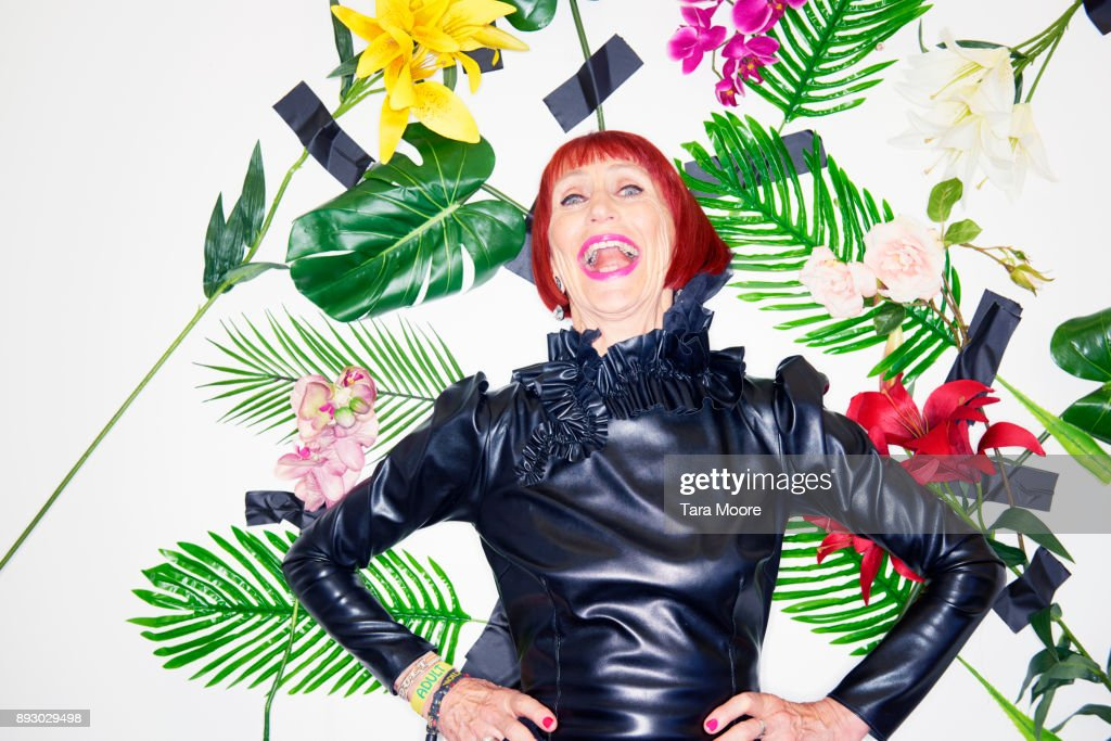 older woman laughing in couture clothing : Stock Photo