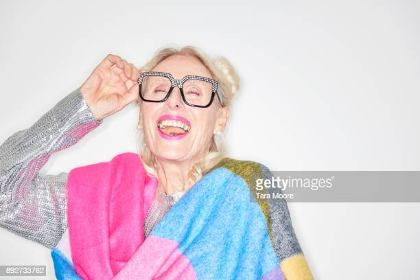 older woman laughing - bontgekleurd stockfoto's en -beelden