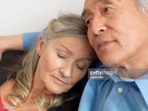 Older woman napping on husband