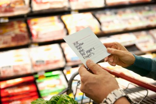 Older woman reading grocery list in supermarket - gettyimageskorea