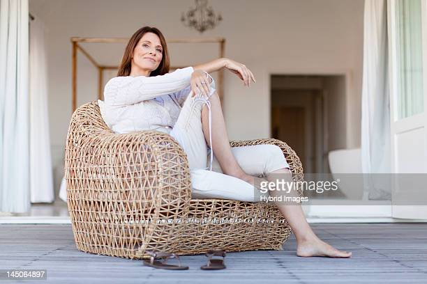 Older woman relaxing in armchair