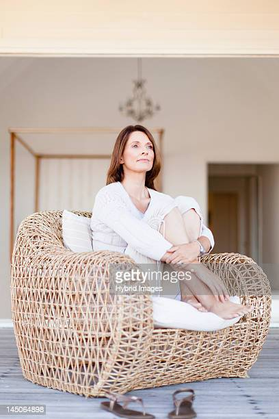 Older woman relaxing in armchair