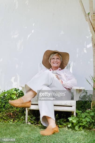 Older woman relaxing in backyard