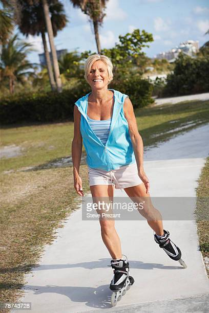 older woman rollerblading - inline skate stock photos and pictures
