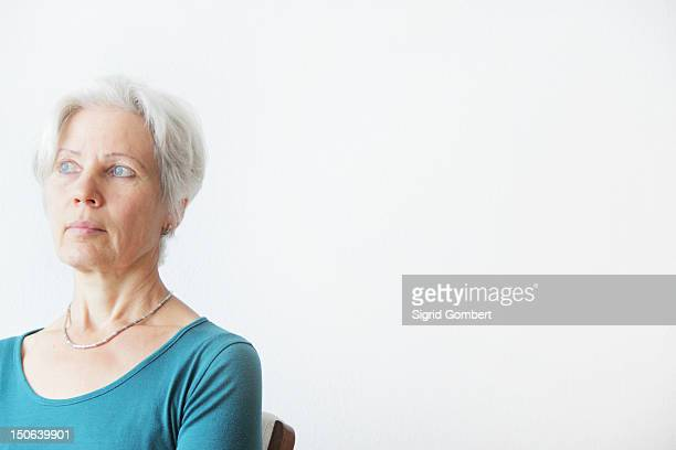 older woman sitting in chair - sigrid gombert stock pictures, royalty-free photos & images
