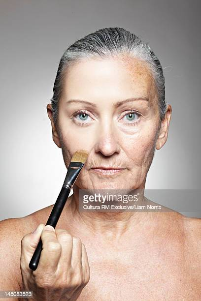 Older woman smoothing her face