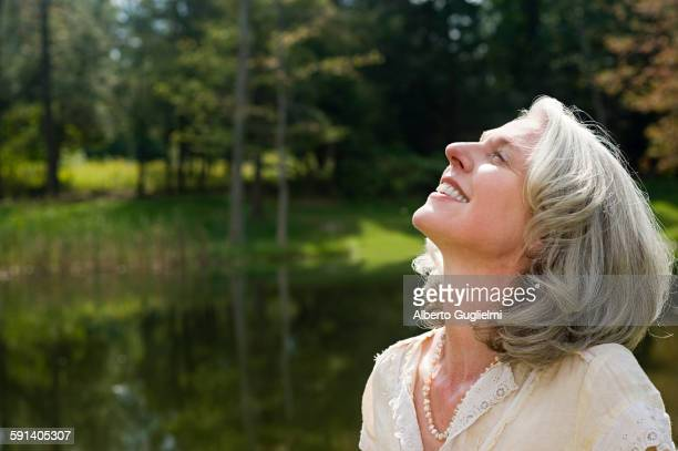 Older woman standing in park