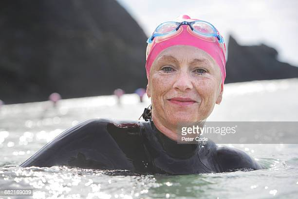 Older woman swimming in the sea